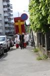 Prosesjonen har rundet hjørnet fra Torggata og er på vei opp Heidmanns gate
